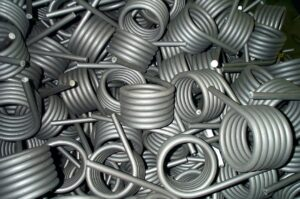 Small torsion springs are small wire thickness springs made with an extending arm at the end for applying torque.
