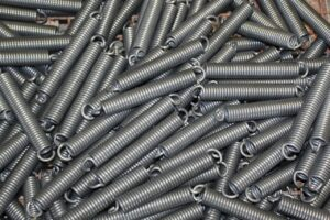 A pile of extension springs (coiled springs with closed ends for hooks)