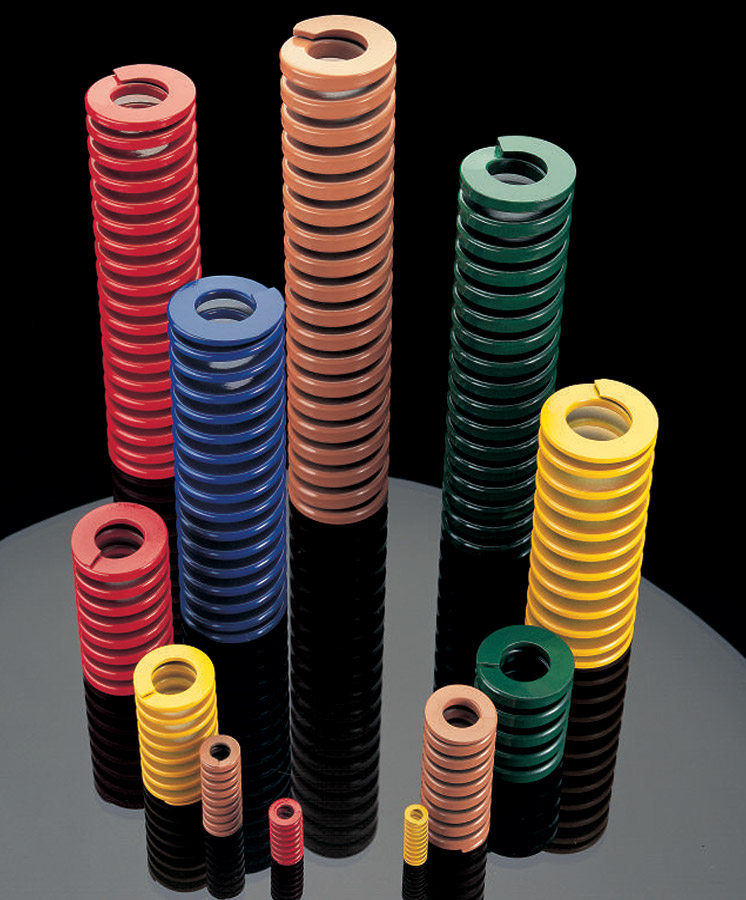 Various colored die springs of different sizes.