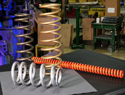 Examples of Mid-West Spring and Stamping's industrial springs, from small to incredibly large applications.