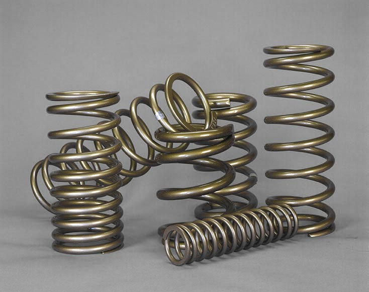 Suspension springs (meant for motorcycles and other vehicles) produced by Mid-West Spring and Stamping.