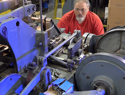 A MWSS technician making sure our Lean manufacturing process continues to meet our ISO Certified standards on our large wireform fourslide.