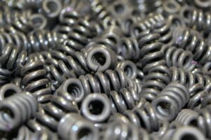 A collection of small compression springs produced by Mid-West Spring and STamping.