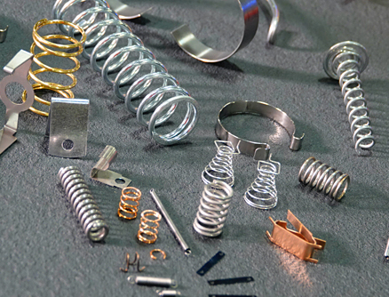 A collection of various springs, highlighting the CNC machining capabilities Mid-West Spring and Stamping can provide.