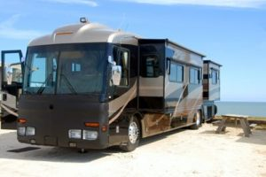 mid-West Spring & Stamping are proud to be rv component suppliers. An expaning room RV at a seaside rest area.