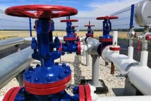 Mid-West provides contract manufacturing services for valve and actuator production. A system of red, white, and blue industrial valves.